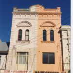 Name on Facade, W. Thompson. Currently Florist and Hairdresser.